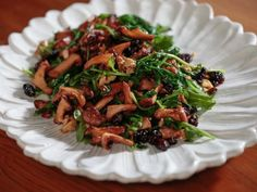 Get Funghi alla Fiorentina (Seared Mushrooms with Wilted Arugula) Recipe from Food Network