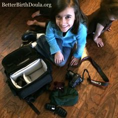 Mini-Doula: my daughter packed her bag as they are playing doula today.  Rice pack, massager, essential oils, camera - she looks ready!