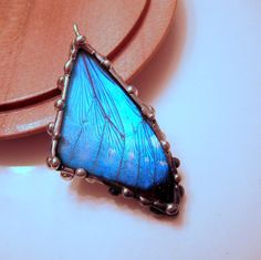 Butterfly Wing Pendant, Blue Morpho, Real Butterfly Wing. $37.00, via Etsy.