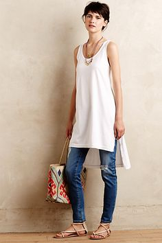 Need a long plain tunic tank in neutral...like the asymmetrical length and thicker straps Very versatile and comfy!
