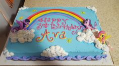 My little pony cake. bright colors with rainbow and clouds. buttercream.