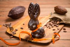 """Lovely boxed Easter bunny made of high quality 75% single origin Tanzanian dark chocolate.Fun, decorative and delicious. A small amount edible food paint and silver shimmer may be applied to the finishing.Size: 210 x 116 X 86 mm, Min. weight 140 gSending this as a gift for someone? Please use the """"Message"""" section below to add your personal message. We will print and include this with your gift pack.You may also use this message section to let us know about your preferences, e.g. ..."""