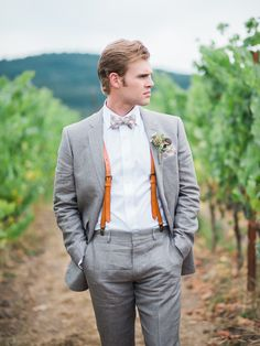 Leather suspenders and a plaid bowtie: http://www.stylemepretty.com/2015/11/04/romantic-summer-wedding-at-zenith-vineyard/ | Photography: Alexandra Grace Photography - alexgracephotography.com
