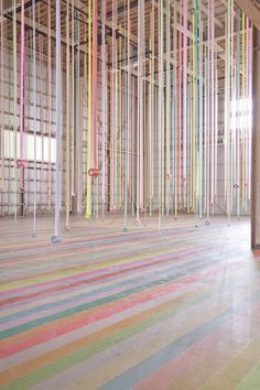 Art director and graphic designer Koji Iyama has been staging installations across Japan to promote the multifunctional uses of mt-masking tape. His latest installation arrived in Sendai, almost 2 years after it was ravaged by the devastating tsunami.  Staged within an old warehouse, and utilizing its high ceilings, Iyama hung hundreds of rolls of masking tape from the ceiling, delineating space and affecting the flow of people.
