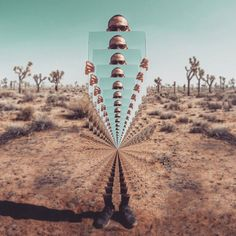 Self-Portraits With a Mirror  Photographer Ari Fararooy has created this futuristic and surreal self-portraits series in the Joshua Tree National Park, California. Using only a camera a tripod and a mirror, it's quite difficult to know how he made it, except through subtle digital manipulations.