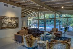 The home's walls of glass bring the swimming pool and attractive landscaping to the forefront of the living experience. Midcentury Post and Beam In Fryman Canyon. Browse inspirational photos of modern homes. Oak Hardwood Flooring, Terrazzo Flooring, Post And Beam, Level Homes, Studio City, Mid Century House, Mid-century Modern, Contemporary, Architecture