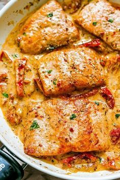 Pan-seared salmon with sun-dried tomato cream sauce — Delectably healthy and ready in 20mins. #seafoodrecipes