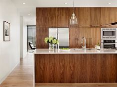 Modern Kitchen Interior Remodeling modern walnut kitchen - Do you dream of owning a modern kitchen? Aside from the typical sleek black or white kitchen, here are 10 amazing modern kitchen cabinet styles to spark your decorating. Walnut Kitchen Cabinets, Contemporary Kitchen Cabinets, Kitchen Cabinet Styles, Kitchen Modern, Warm Kitchen, Hickory Kitchen, Dark Cabinets, Taupe Kitchen, Classic Kitchen