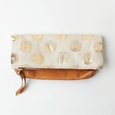 gold dotted clutch / poketo.