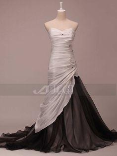 He encontrado este interesante anuncio de Etsy en https://www.etsy.com/es/listing/170732254/black-and-white-wedding-dress-gothic