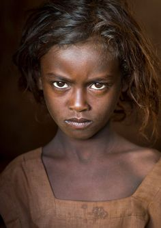 Borana tribe kid, Kenya. The Borana are rather poor and live in little farms. Most of them are no longer like the ethiopian Boranas who remain nomads. www.ericlafforgue.com
