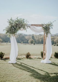 Ceremony arch with greenery and ivory draping, simple ceremony decor that is als. Ceremony arch with greenery and ivory draping, simple ceremony decor that is also impactful and elegant. Wedding Ceremony Arch, Wedding Altars, Wedding Ceremony Decorations, Wedding Arches, Wedding Arch Greenery, Outdoor Ceremony, Greenery Decor, Church Decorations, Wedding Centerpieces