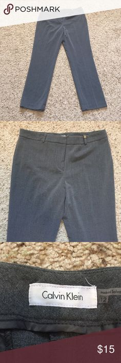 Calvin Klein grey Trouser pants size 12 Calvin Klein grey Trouser pants. Size 12. In great condition, only worn a few times! Great for work! Calvin Klein Pants Trousers