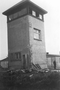 """SS guards of the Dachau concentration camp lie dead next to observation tower B shot by men of the US 42nd Infantry Division. In all, some 500 SS were """"neutralized"""" according to General Eisenhower."""