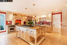 Traditional Kitchen with Inset cabinets, Almond Gold Granite Countertop, Ms international angelica gold travertine tile