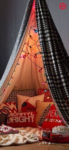 This would be such a cozy way to spend Christmas Eve- with some comfy Christmas themed pillows, soft, furry blankets, fairy lights, Christmassy caramel popcorn, peppermint hot chocolate and a Christmas movie- all from the comfort of a cubby!