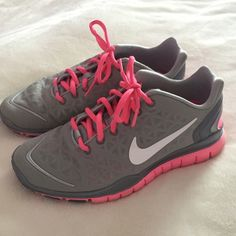 Nike free runs In really good condition! Pink and gray Nike free runs 2 Nike Shoes Sneakers