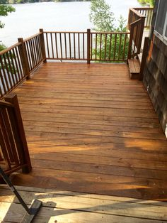 Final coat of Olympic cedar Naturaltone on the side deck. Same color that the wood turned when we power washed.