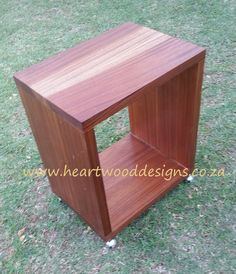 Mahogany bedside pedestal on casters for easy mobility.