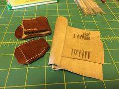Leather thimbles and needle holder I made.