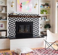 We're pretty sure these graphic tiles were born for this fireplace! This space is just perfection Design/Repost: Photo: Living Room With Fireplace, My Living Room, Living Room Decor, Living Spaces, Small Living, Dining Room, Fireplace Tile Surround, Fireplace Surrounds, Tiled Fireplace