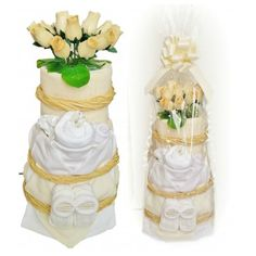 Coffee & Cream Deluxe Nappy Cake  A truly amazing unisex centrepiece nappy cake. 3 glorious tiers of neutral cream 'frosting', simply bursting with everything a new mother could need for her beautiful bundle.  Please note: the 6-12month cakes will replace the booties and scratch mitts with 2 pairs of socks.  For a full list of ingredients follow the link below http://www.babybooboutique.co.uk/#!/Coffee-&-Cream-Deluxe-Nappy-Cake/p/50145145/category=13048169