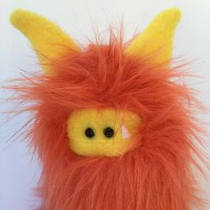 A purse sized Fuzzling!  Look at that cute face :)   Contact me for details or check out my current Fuzzlings ready for adoption on Etsy.