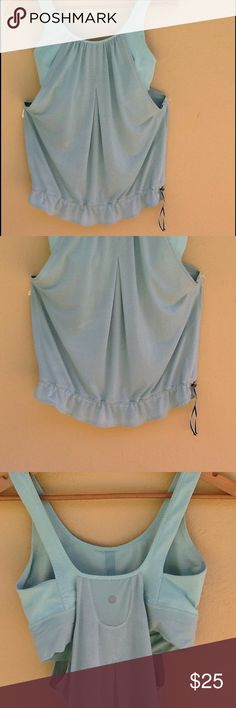 Lululemon tank top Tank top with built in bar. This style does not have the pads in the bra top. Draw string bottom. Sea foam green. Size 8 as shown on inside bra top. lululemon athletica Tops Tank Tops