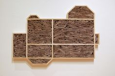 "Lisa Kellner Sculpture Thousands of ""bricks"" cut from recycled newspapers, Custom made wood frame."