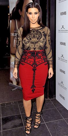 KIM KARDASHIAN  Kanye's main squeeze shows off her famous figure in a delicately embroidered red-and-black Emilio Pucci number and super-strappy sandals to promote her fragrance in London.