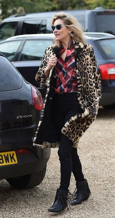 Kate Moss might say she's bad at selfies, but she'd rock an #OOTD post so hard. Loving her red plaid shirt, leopard coat, and fringed ankle boots.
