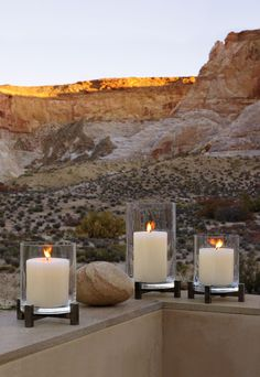 Furniture always enhanced by soft glowing candles in crisp clean glass