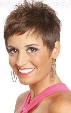 Short, sassy pixie! The soft brown hair color makes this look more youthful & really brings out the eyes. www.dmazsalon.com