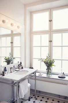 A simple classic bathroom. Those windows...