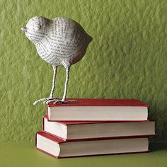 DIY inspiration: Paper mache bird with wire feet, wrapped in newsprint by West Elm.