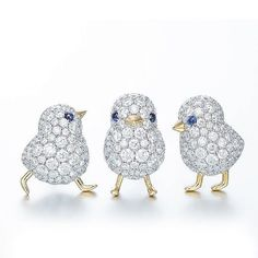 Chicks brooches made of platinum, yellow gold, sapphires and diamonds by GIMEL.