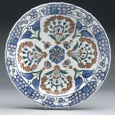 Dish with floral bouquets Ceramic (stonepaste, thrown), with copper-green, cobalt-blue, iron-red, and chromium-black paint, and transparent...