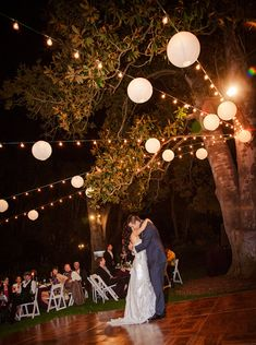 Twinkle lights and lit lanterns make for a magical outdoor reception area.  Such an easy DIY and makes all the difference in your reception lighting & photos