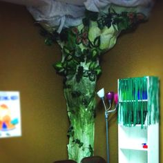Awesome classroom beanstalk!  Silk  plants, chicken wire, ripped up vacuum cleaner bags (very durable material), and newsprint paper dipped in green dyed starch!  Love how awesome it looks!