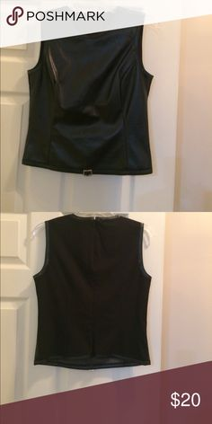 Top Manmade leather front nice rayon/Lycra blend back, sharp looking fitted top, great with jeans or a pencil skirt... worn once.. The Limited Tops Blouses