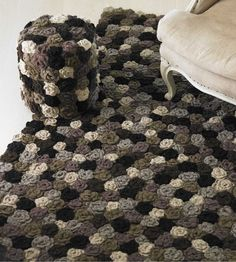 hand crocheted wool Meadow Flower Rug.....and pouf.........from VivaTerra.....