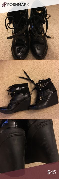 Michael Kors wedge sneakers Black leather and suede Michael Kors wedge sneakers. Only worn a handful of times, but they are in good condition. Scuff markings on the back which I showed in the last pic. KORS Michael Kors Shoes Athletic Shoes