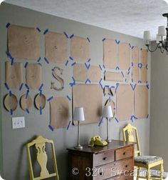 10 Tips for Creating a Collected Gallery Wall at TidbitsAndTwine. Checkout this handy idea from 320 Sycamore for laying out and hanging a gallery wall using paper templates so that you can move them around until you get them positioned just how you want! If when making the templates you also mark where the nail goes, once you have a layout you like, you can put the nails in the wall, tear away the templates, and you're ready to hang!