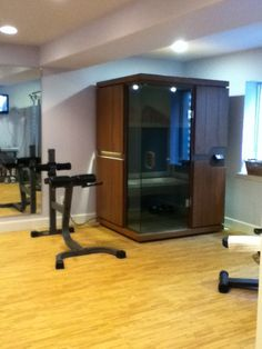 Awesome home gym with Sunlighten's mPulse full spectrum infrared sauna