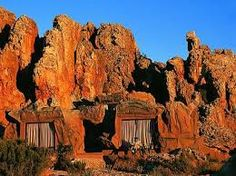 Kagga Kamma private game reserve is located in an untouched wilderness area near Citrusdal in the Western Province of South Africa. Huts are nestled between sandstone formations. Private Games, Provinces Of South Africa, Wilderness, Monument Valley, Mount Rushmore, Tourism, To Go, Ocean, Turismo