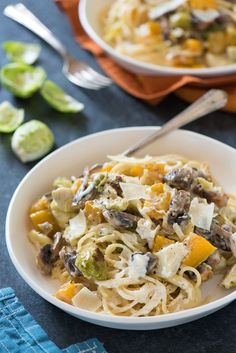 Creamy Roasted Autumn Vegetable Pasta - Celebrate fall's bounty with this creamy pasta tossed with roasted butternut squash, brussels sprouts and mushrooms. | foxeslovelemons.com