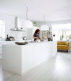 love the mustard sofa in the open kitchen