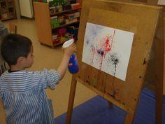 Kunstwerk maken door verf te spuiten.  (Jackson Pollock. Escola Reina Violant de Bcn - P3)