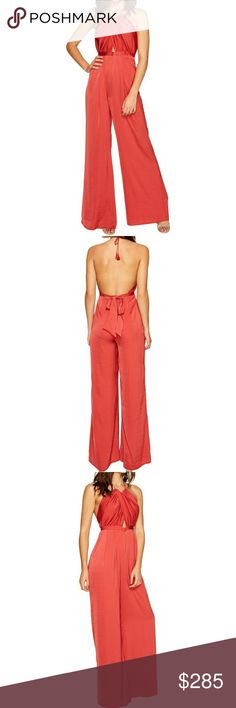 🌹The Karisimbi Scarlet Jumpsuit! 🌹The Karisimbi Scarlet Jumpsuit! This hot & sassy jumpsuit offers relaxed fix, v-neck, halter tassel tie, sleeveless, banded waist with self ties at back, open back, lined, flared led & made of 100% polyester.  🌹NWT- BRAND NEW WITH TAGS 🌹100% AUTHENTIC 🌹NO HOLDS/NO TRADES 🌹OFFERS ACCEPTED THROUGH THE OFFER BUTTON  🚫PLEASE FOLLOW CLOSET RULES AND BE RESPECTFUL THIS IS A BUSINESS THANK YOU The Jetset Diaries Pants Jumpsuits & Rompers