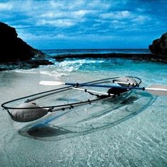 Kayak in a clear boat in clear water